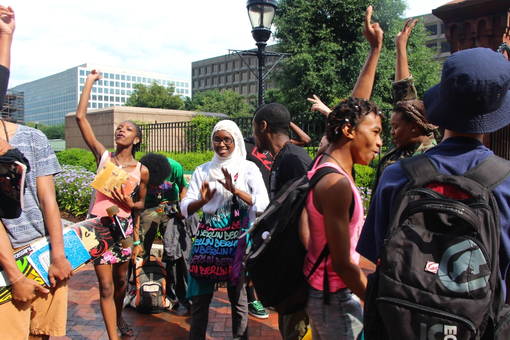 After a successful meeting at the Smithsonian African Art Museum on the National Mall, students of the DC Youth Slam Team celebrate outside with an impromptu dance party and freestyle cypher. The DC Youth Slam Team brings together teenage poets across lines of race, religion, socioeconomic status, and sexuality to use spoken word poetry to raise and challenge issues of social justice and build peace (July 2013).