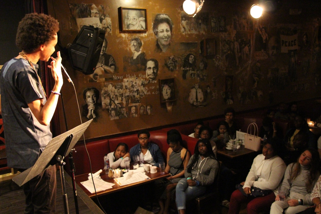 Clear featuring on stage in the Langston Room at Busboys and Poets